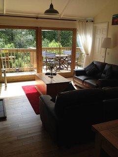 Look out onto the beautiful woodland from the cosiness of the lodge.