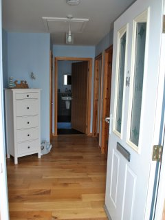 The welcoming hallway is light and bright, with plenty space to store golf clubs!