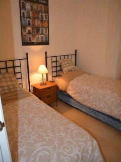 Second bedroom - 2 single beds; 3rd bed available underneath single bed.