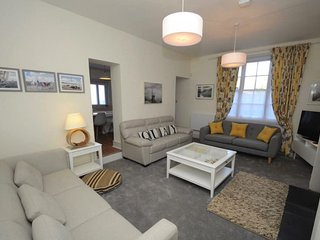 Comfortable lounge with LED TV  offering Virgin Media package, wood burner for cosy winter nights.