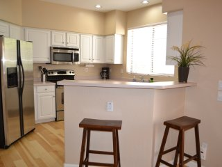 Kitchen with pantry, breakfast bar and stainless steel appliances.