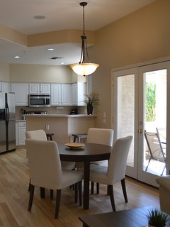 Dining area with double french door entry to patio.