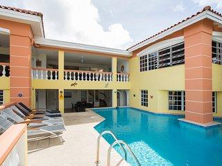 Left side first floor living area balcony, left ground floor bedroom 1.