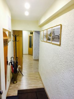 entrance hallway surrounded by gallery of old photographs of Bratislava