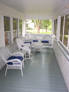 If it's too hot by the pool, enjoy a shady spot on the screened porch at the front of the house.