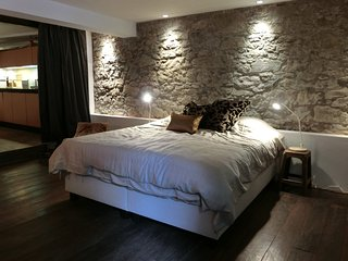 Bedroom with historical wall