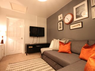 Living room with flat screen and Freeview TV