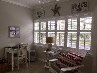 Sun Room overlooks tropical boulevard