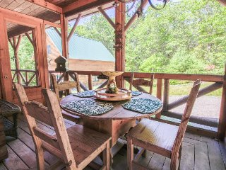 Beautiful log cabin w/ forest views & wrap-around deck - close to town & beach!