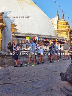 Clockwise circling the Swoyambhunath stupa dome.