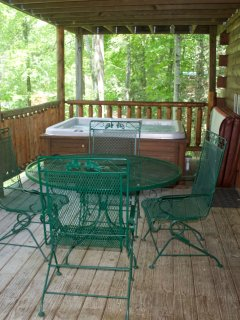 Enjoy a meal or snack on the deck beside the hot tub.