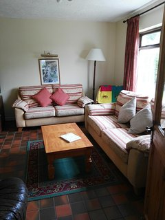 Comfortable bright sitting room. Books and games provided for nights in. DVD player.
