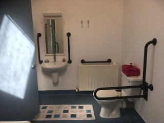 Disabled friendly large family shower room in shared amenities block a short walk away