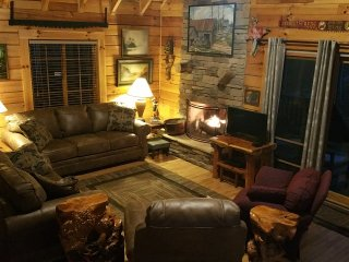 Enjoy a Cozy Fire in the Great Room At Big Rock Log Cabin.