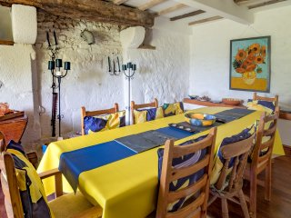 Van Gogh dining room with room for all the family to feast in.