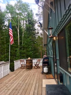 The private decks features a grill, swing, and a hot tub.