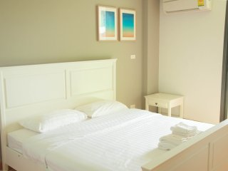 One-Bedroom Apartment w SofaBed_4H: Pool View Partial - Rocco HuaHin Condominium