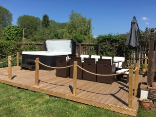 Decking area with dining table and chairs