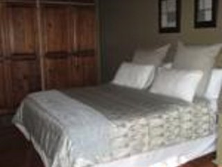 CARLOW SUITE: One bedroom (queen size bed) with full en-suite bathroom.Deck-view