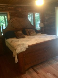 Master bedroom with ceiling fan and very comfortable king bed.