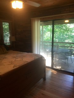 Master bedroom has sliding glass door leading to wrap around porch.