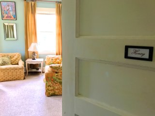 Door into The Honey Room in the Clarksdale White House. King-size bed. Comfortable sitting area.