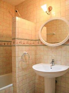 Bathroom with bath and overhead shower