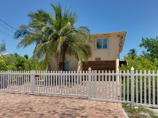 Water view home situated on canal, w/ private dock, patio, and enclosed yard
