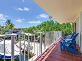Bayfront condo w/ balcony, covered deck, shared enclosed yard and dock