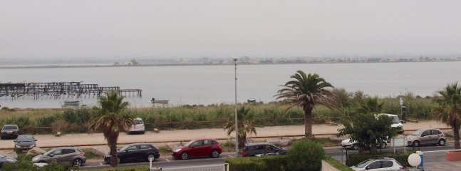 View back cover over ponds, oyster park, the car park entrance. In the distance Montpellier