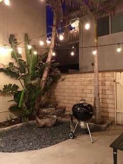 Barbecue under the lights in the private courtyard
