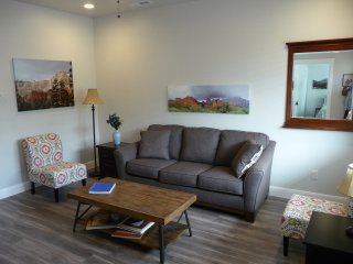 The living room is simple and a great place to relax and put your feet up