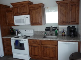 The kitchen has solid alder cabinets and full size appliances