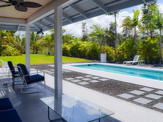 The in-ground pool is surrounded by a lanai and patio
