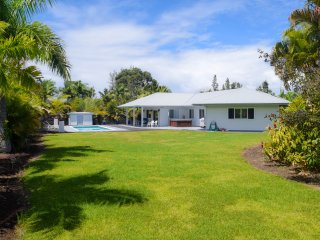 The large grassy fenced yard is meticulously landscaped and provides excellent privacy.