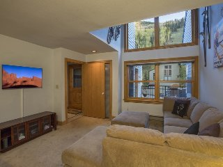 The cozy living room area is perfect for catching a movie, and the mountain is just right there.