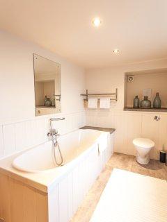 Family bathroom - bath with handheld shower
