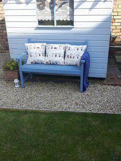 Relax in the seaside themed garden