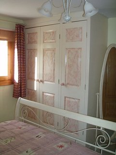 Guest bedroom 1 fitted hand painted wardrobes.