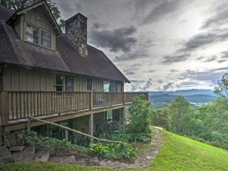 This amazing property offers unparalleled views of the French Broad River Valley