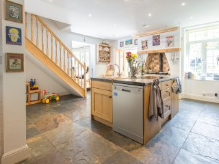 The lovely spacious kitchen, with traditional granite tiled floor.