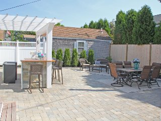 Large back patio to enjoy the outdoors! Gads Grill -table -chairs - Bar area with Flat Screen TV! - 5 Sea Breeze Avenue Harwich Port Cape Cod - New England Vacation Rentals