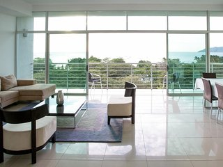 Dog-friendly oceanview condo w/ private balcony & shared pool - steps from beach