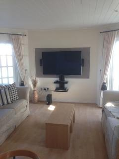 Modern living space with SKY tv