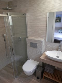 En-suite bathroom for room 3 with rainfall shower