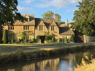 Voted Most Beautiful Village in England, a Storybook 6br Cotswold Riverside Home