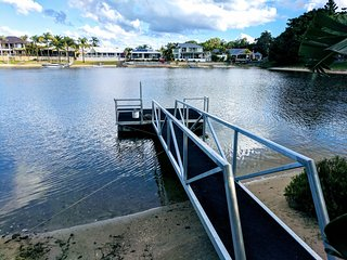 JUST IN PARADISE Waterfront 5 bedroom home with pool in great central location