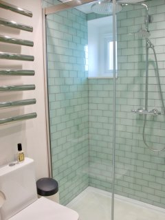The bathroom has heated flooring and heated towel rail.