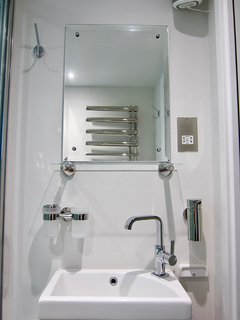 There is also a shaving point and a de-misting mirror in the bathroom.
