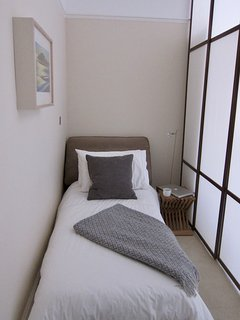 Single sofa bed with the Japanese blind offering visual privacy.